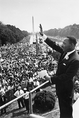 28th August 1963: American minister and civil rights leader Dr Martin Luther King Jr (1929 - 1968) waves to the crowd of more than 200,000 people gathered on the Mall during the March on Washington after delivering his 'I Have a Dream' speech, Washington, DC. (Photo by Hulton Archive/Getty Images)